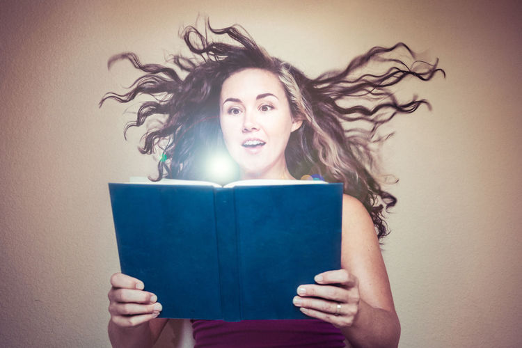 Amazement Book Book Reading Bright Light Face Fantasy Front View Glowing Hair Flying Holding Book Imagination Light Flare Long Hair Magical One Person Orb Portrait Reading Studio Shot Supernatural Surprised Surreal Woman Wonder