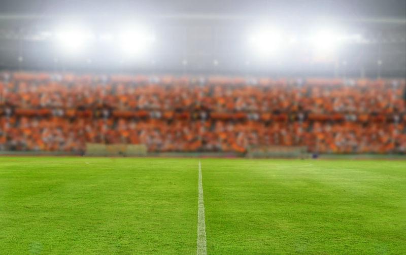 Illuminated soccer field at night