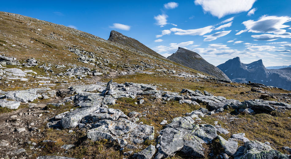 Autumn Cloud Hiking Nature Northern Norway Norway Rock Rock Formation Adventure Beauty In Nature Blue Sky Day Fall Landscape Mountain Mountain Peak Mountain Range Nature Nordland County Outdoors Rock - Object Scenics Sky Summit Water Perspectives On Nature