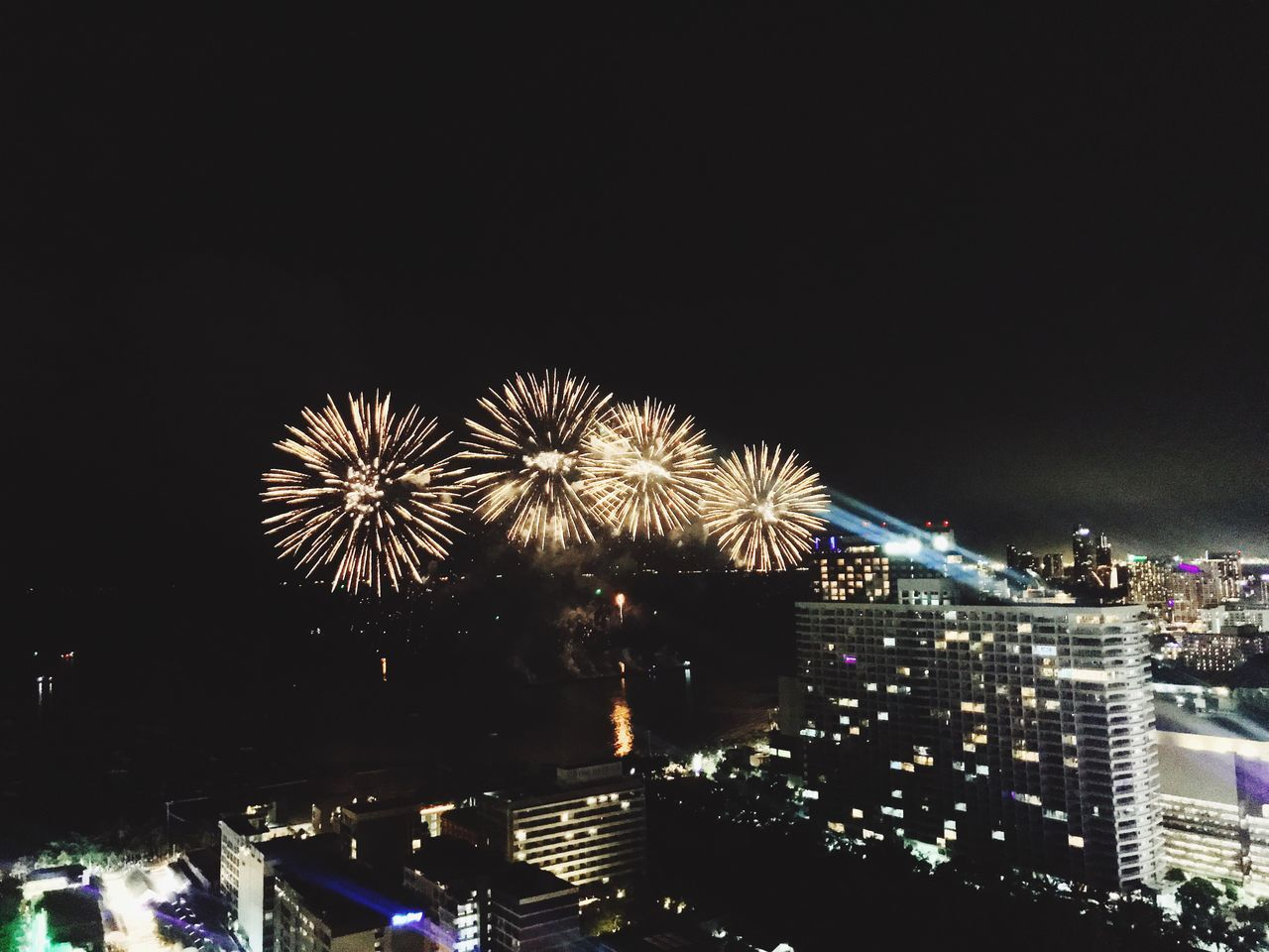 illuminated, night, building exterior, architecture, firework, built structure, city, firework display, arts culture and entertainment, sky, exploding, celebration, event, motion, glowing, copy space, nature, no people, long exposure, cityscape, firework - man made object, light, outdoors, sparks, office building exterior