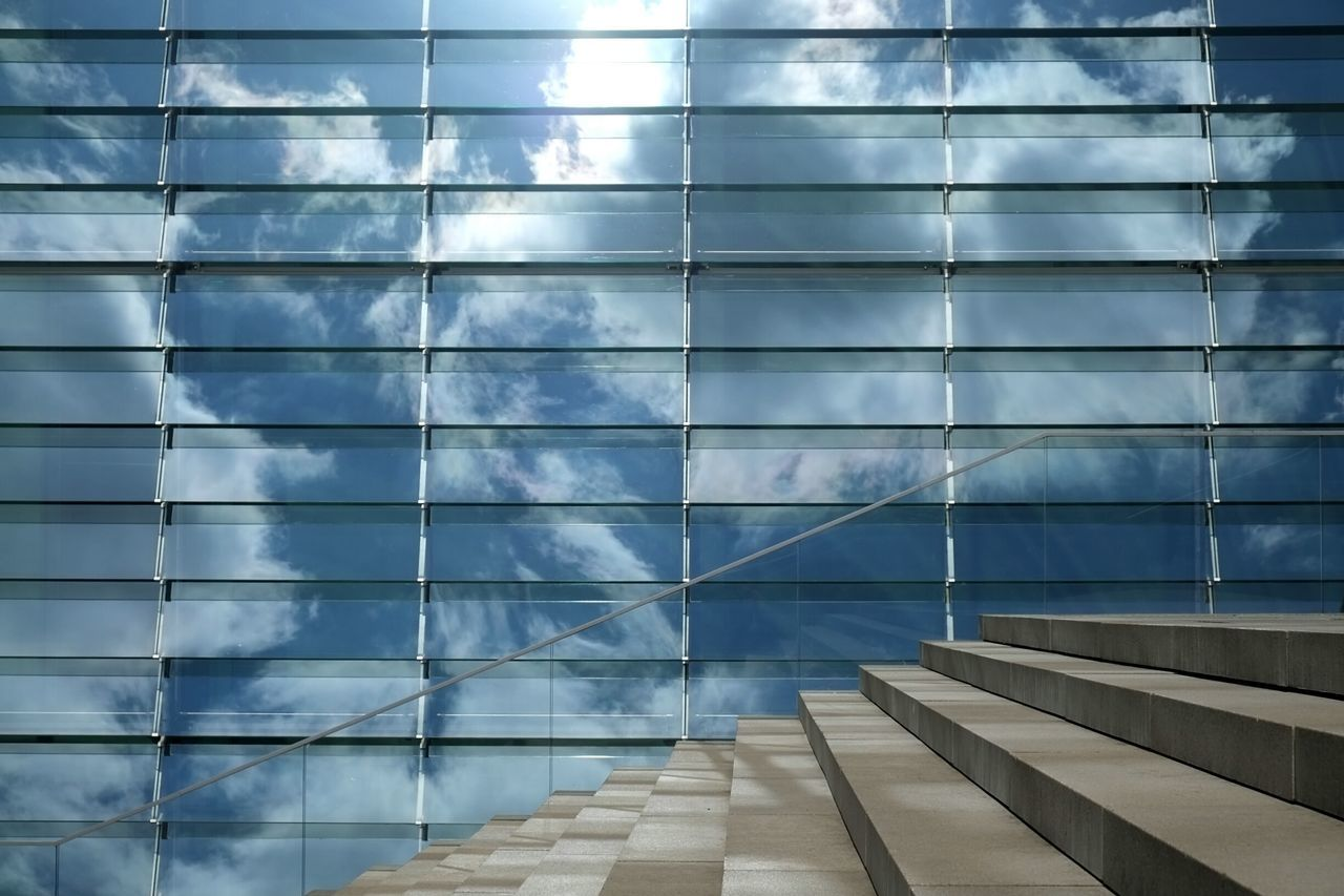 Reflection of clouds in office building