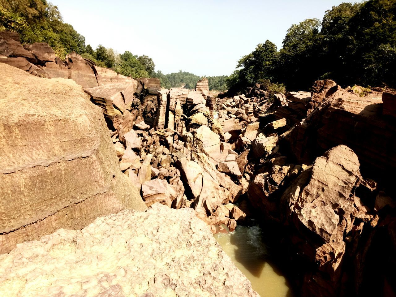 nature, rock - object, rock, tranquility, beauty in nature, landscape, no people, outdoors, cliff, adventure, day, tree, sky