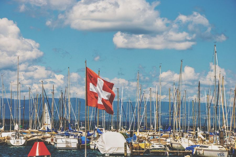 Nautical Vessel Identity Flag Patriotism Transportation National Flag Mode Of Transport Boat Sky Mast Moored Harbor Cloud - Sky American Flag Wind Pole Flag Pole Water Pride In A Row Jetdeau Geneva