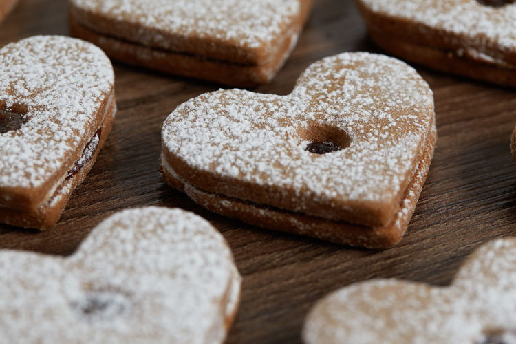 Close up of freshly baked homemade Christmas sugar cookies with jam Food Food And Drink Indoors  Freshness Baked Close-up Bread Still Life Studio Shot No People Group Of Objects Sweet Food Sugar Choice Variation Indulgence High Angle View Selective Focus Wood - Material Healthy Eating Powdered Sugar Temptation Breakfast Homemade Freshness Jam Freshly Baked Freshly Cookies Cookie