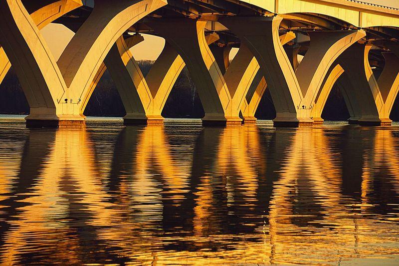 Reflection of bridge in water