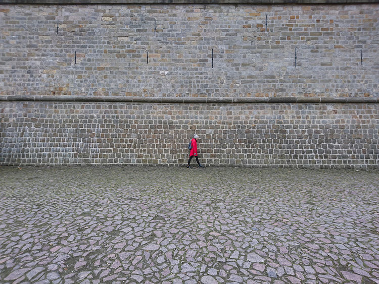 Day Dresden Full Length Leisure Activity Lifestyles One Person Outdoors People Real People Red Jacket Wall Water