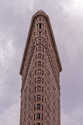 Low angle view of flatiron building against sky at dusk