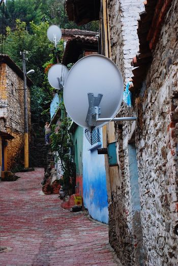 Stories From The City Colorful Colorful Houses Pavedstreet Paved Road Pavedstreets Turkish Village Village İzmir Tire Turkey Türkiye Streetphotography Street Photography Pastel Power Communication Televison Absurd Tecnology Satellite Dishes Satellitedish Satellite Dish Travel Photography Travel EyeEm Diversity The Street Photographer - 2017 EyeEm Awards