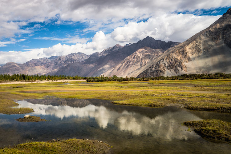 Beauty In Nature Cloud - Sky Countryside Day Grass Himalayan Range India Lake Landscape Leh Ladakh.. Majestic Mountain Mountain Range Nature No People Non-urban Scene NubraValley Outdoors Scenics Sky Tranquil Scene Tranquility Water