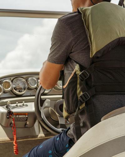 Rear view of man sailing speedboat