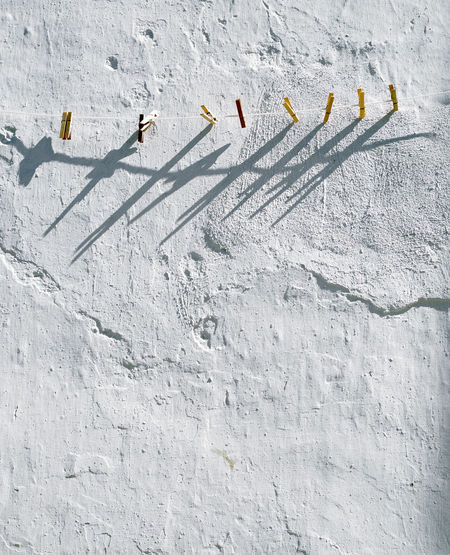 Wall - Building Feature Day No People Sunlight Nature Built Structure Architecture Shadow White Color Outdoors Textured  Wall Pattern High Angle View Group Of Animals Cold Temperature Protection Group Land Wooden Pegs Washing Line Washing Line Morning Sunshine Laundry Line