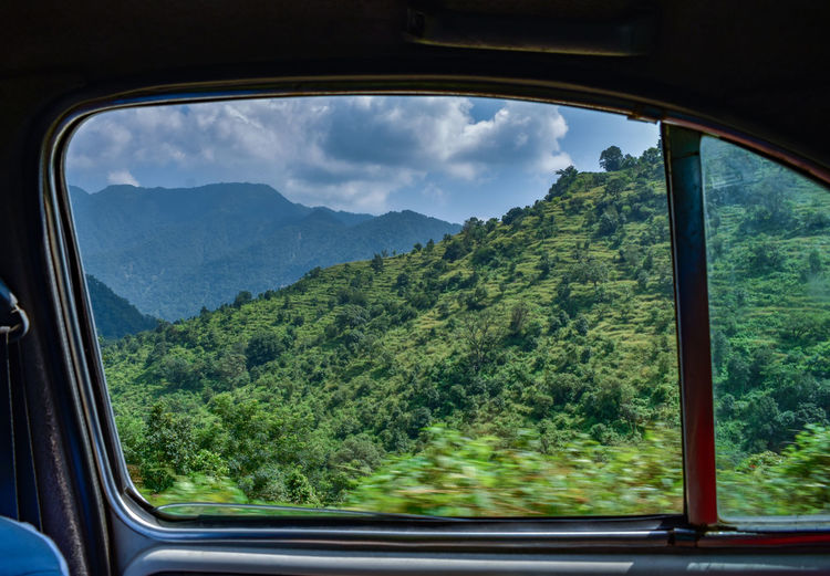 Scenic view of mountains seen through car window
