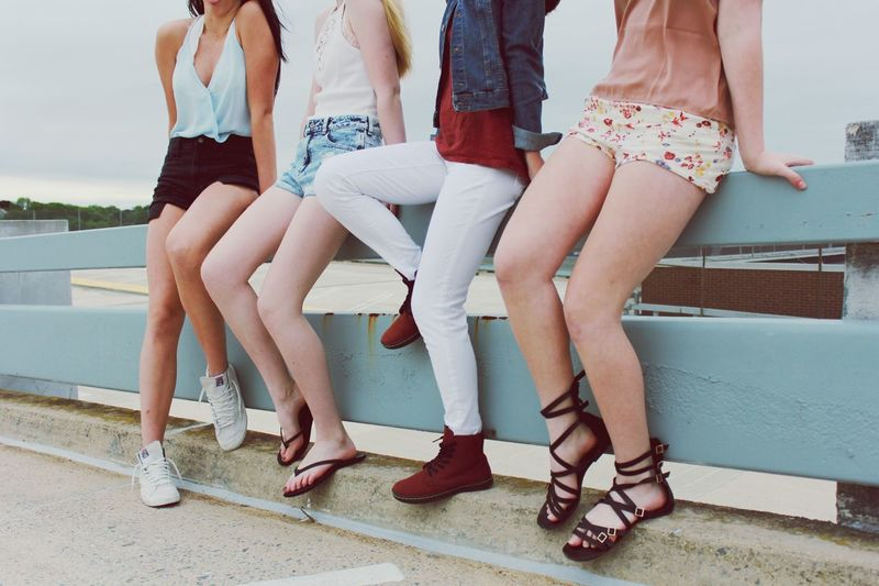 Low section of teenage girls standing outdoors