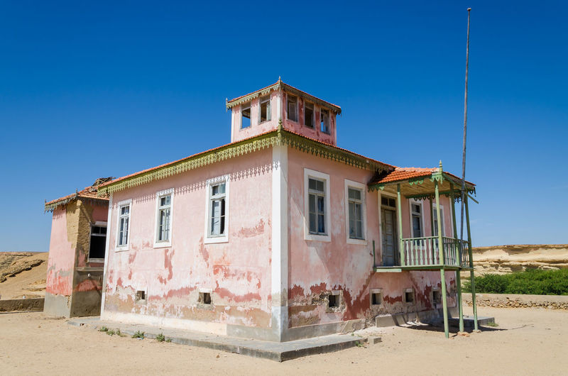 Old colonial building against clear blue sky, mucuio, angola