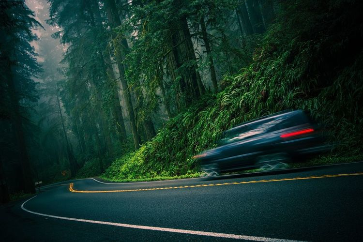 Blurred motion of car on mountain road