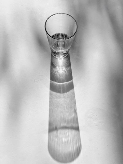 High angle view of glass of water on table