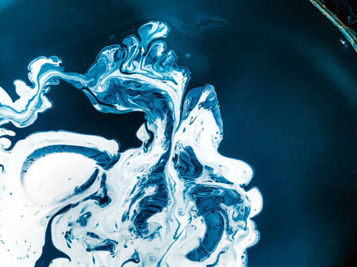 Close-up of water splashing against blue background