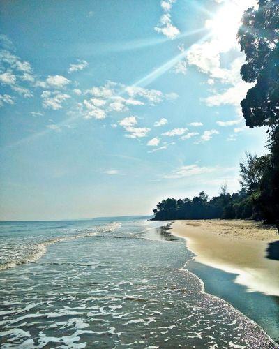 Sea Water Beach Sky Scenics Horizon Over Water Tranquility Nature Beauty In Nature Tranquil Scene Cloud - Sky Outdoors Sunlight Sand Tree Photographing Taking Photos Lifes A Beach Beachphotography Beachday Beachlife Beachlovers Beachbum