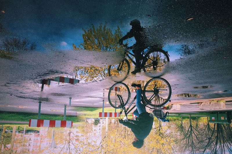 Beauty In Nature Bycicle Colors Day Dream Fantasy Illuminated Life Mirror Nature Outdoors Plant Rain Reflection Sky Spring Street Tree Water