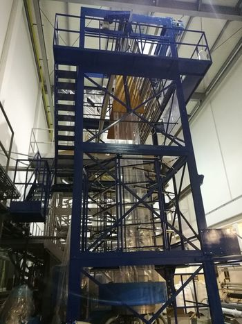Metal Industry Golf Club Spiral Staircase Girder Factory Industry Manufacturing Equipment Working Steel Foundry Plastic Environment - LIMEX IMAGINE Plastic Environment - LIMEX IMAGINE