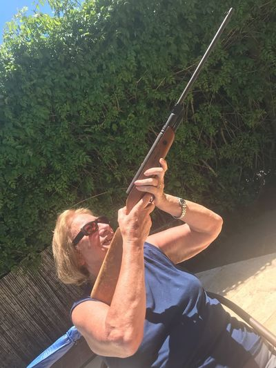 Becareful ! Aiming Shot Riffle Gun Real People Leisure Activity Lifestyles One Person Plant Tree Day Nature Sunlight Adult Growth High Angle View Casual Clothing Outdoors Women Green Color Holding Enjoyment