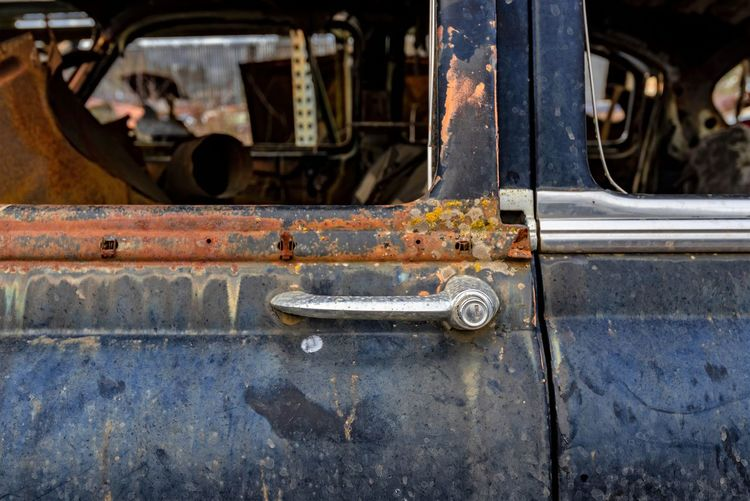 Abandoned Car Car Door Close-up Damaged Day Decline Deterioration Focus On Foreground Land Vehicle Metal Mode Of Transportation Motor Vehicle No People Obsolete Old Retro Styled Run-down Rusty Transportation Travel Weathered Wheel
