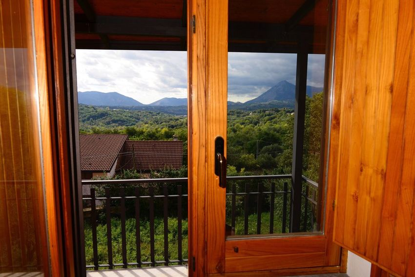 EyeEm Selects Window Mountain Wood - Material Indoors  Open Nature No People Day Mountain Range Sky Beauty In Nature Scenics Landscape Architecture Tree Close-up Campania Sannio Terrirorio Sannita Hilly Landscape Panorama From A Balcony