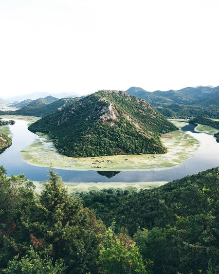 Beautiful view on the calm river bend at the Skadar Lake in Montenegro. Green Nature Beauty In Nature Day Environment Green Color Growth Idyllic Landscape Montenegro Mountain Nature No People Non-urban Scene Outdoors Plant Scenics - Nature Skadar Lake, Montenegro Sky Tourism Tranquil Scene Tranquility Tree Viewpoint Water