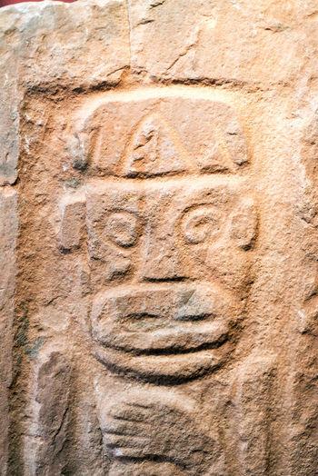 Ancient stone carving in small town of Pucara near Cusco, Peru America Ancient Antique Art Background Culture Cusco Cusco, Peru Cuzco Face History Idol Inca Indian Peru Prehispanic Pucara Religion South South America Stone Symbol Texture Traditional Travel