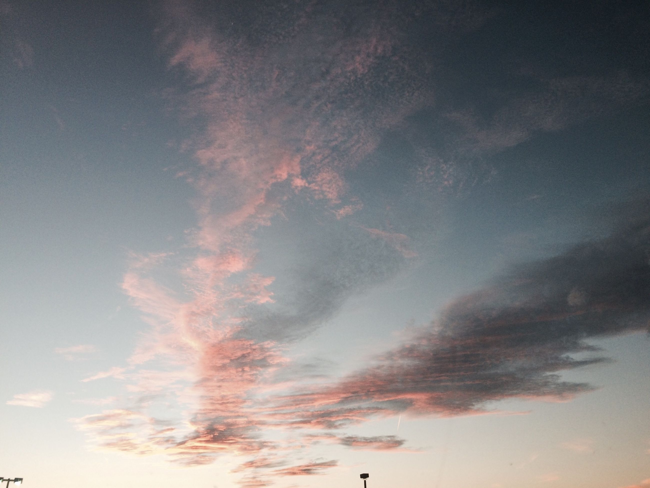 low angle view, sky, cloud - sky, beauty in nature, tranquility, scenics, cloudy, nature, sunset, tranquil scene, sky only, cloud, idyllic, outdoors, silhouette, no people, flying, cloudscape, backgrounds, weather
