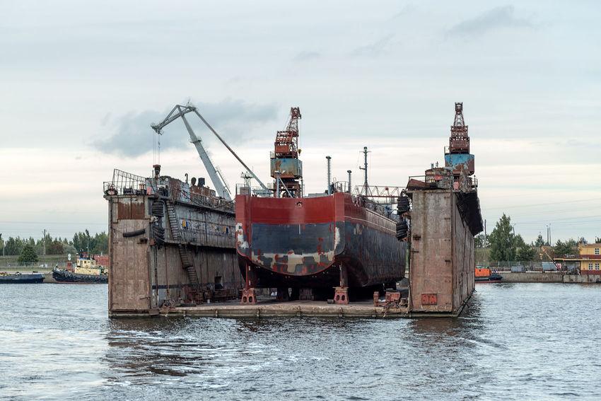 Ship repairs floating docks. Cranes Harbor Heavy Industry Transport Boats Docks Equipment Export Import Load Logistic Material Port Repair Scrap Sea Seaside Steel Storage Terminal Transshipment Terminal Unload Vessel
