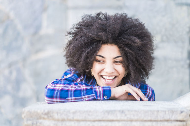 Young beautiful african hair young woman laughing and enojying in outdoor city place - cheerful hipster girl laugh and live with joy - female portrait with african hairstyle Smiling Happiness One Person Emotion Portrait Curly Hair Young Adult Young Women Cheerful Headshot Afro Adult Women Looking At Camera Hair Front View Toothy Smile Beauty Teeth Hairstyle Beautiful Woman Checked Shirt Enjoying Life Millennial Beautiful People Two People Music Listening To Music Eyeglasses  20-24 Years Sitting Staircase Sunlight City Life Student Blue Color Hipster - Person One Woman Only Attractive