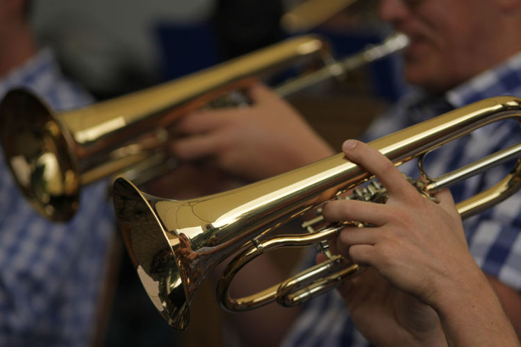 Close-up of men playing euphonium