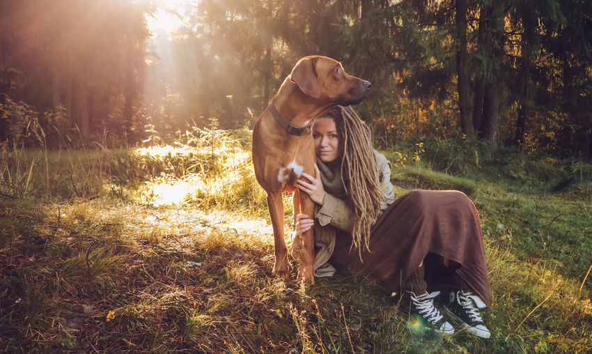 Plant Tree Land Real People Leisure Activity Young Adult Young Women Lifestyles Nature Forest Sunlight Grass Adult Women Field Long Hair People Togetherness Hair Hairstyle Couple - Relationship Outdoors Lens Flare Autumn Mood