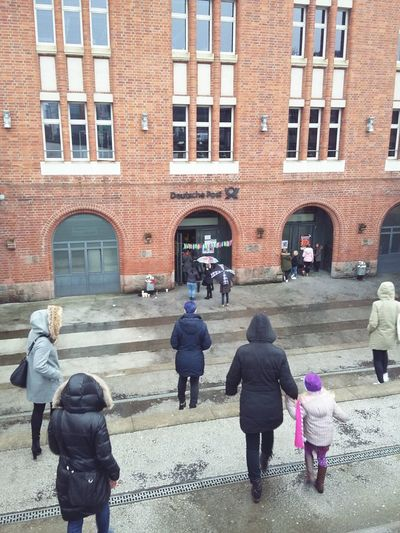 To the Fleamarket. · Hamburg Germany 040 Flea Market Fleamarkets Entrance Post Office Women Winter Down The Stairs Capture The Moment