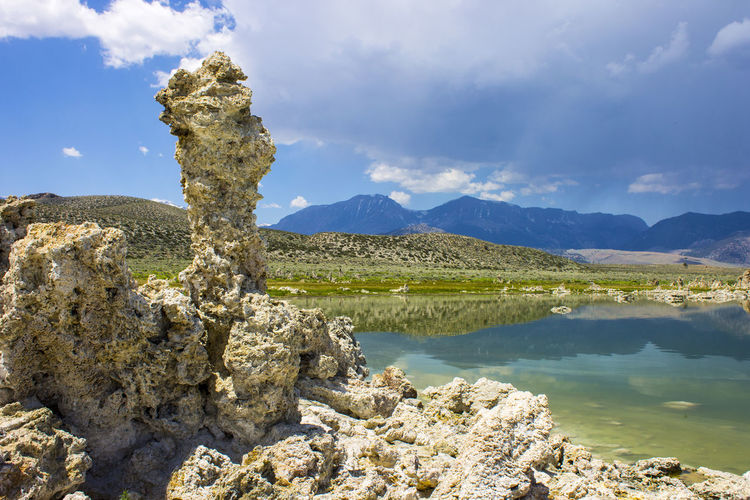 Mono Lake, a large, shallow saline soda lake in Mono County, California, with tufa rock formations Beauty In Nature Cloud - Sky Day Lake Landscape Mono Lake Mono Lake California Mountain Nature No People Outdoors Rock - Object Scenics Sky Tranquil Scene Tranquility Tufa Water