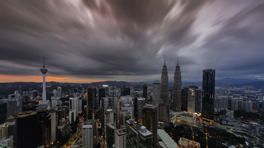 A panoramic aerial night scape of Kuala Lumpur city Cloud - Sky Building Exterior Sky City Architecture Built Structure Cityscape Building Office Building Exterior Skyscraper Modern Tall - High Tower Sunset Nature Travel Destinations Dusk Crowd Urban Skyline Crowded Outdoors Financial District  Spire