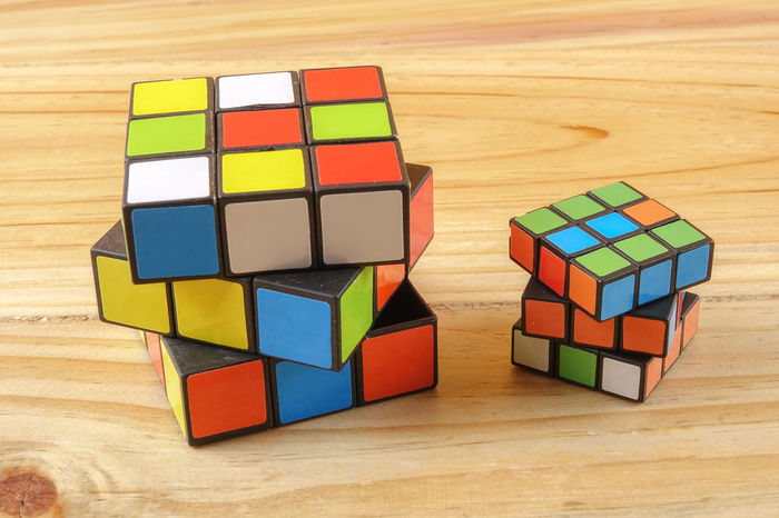 RUBIK'S CUBE , CREATIVITY TOY Creativity Rubik Cube Block Childhood Choice Close-up Creativity Cube Shape Design Geometric Shape Indoors  Intelligence Large Group Of Objects Multi Colored Puzzle  Rubik Shape Still Life Table Toy Toy Block Variation Wood - Material