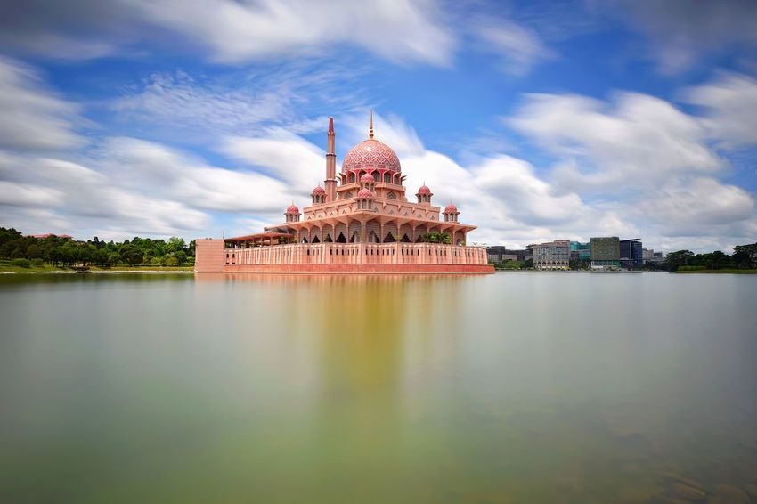 Putrajaya mosque on sunny day Masjid Architecture Sky And Clouds View Travel Outdoor Travel Destinations Landscape Skyline Sky Long Exposure Getty Images EyeEm Best Shots EyeEm Selects Politics And Government City Cityscape Water Urban Skyline Sunset Blue History Royalty River Palace Dome Mosque Islam Place Of Interest Place Of Worship