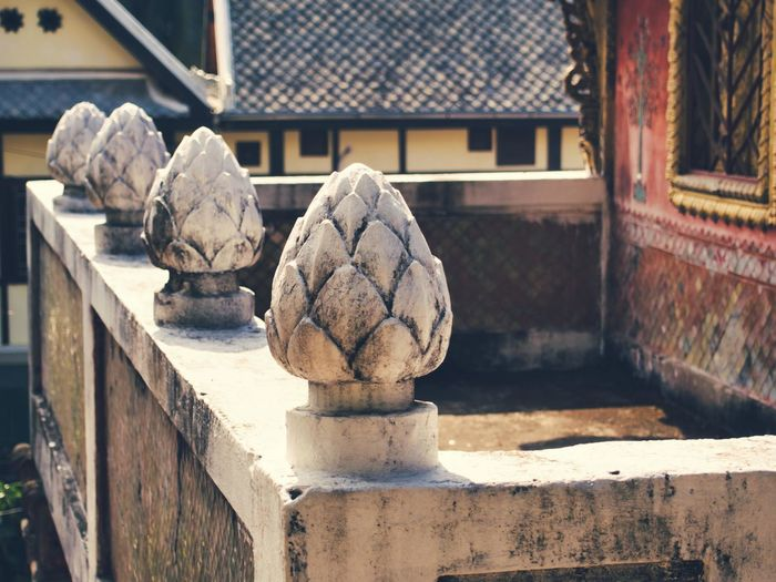 Stone bud on a temple in luang prabang, laos