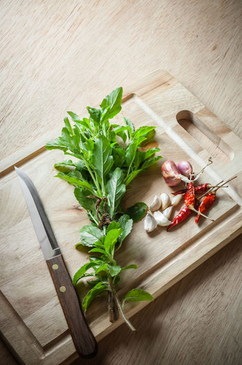 Basil Chili  Chilli Chopping Block Close-up Cooking Flower Head Freshness Garlic Green Herbal Medicine Indoors  Knife Leaf No People Onion Raw Food Sage Wood - Material