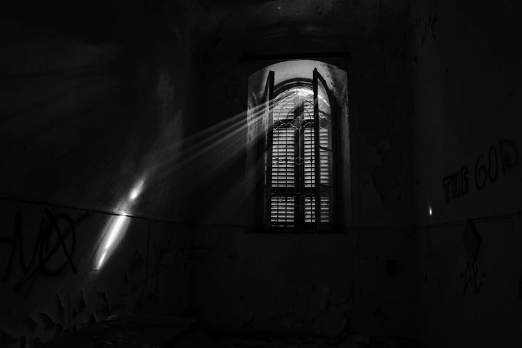 Architecture Built Structure Indoors  Building Wall - Building Feature Low Angle View No People Illuminated Abandoned Night Dark Window Wall Old Place Of Worship Religion Spirituality Ceiling Rays Of Light Mental Hospital  Moody Blackandwhite Photography