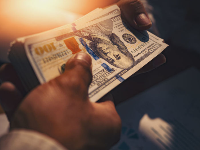Businessmen give money to his partner, business concept. Human Hand Hand Holding Human Body Part Currency Men Business Paper Currency Finance One Person Wealth Real People Leisure Activity Indoors  Finger Selective Focus Human Representation Body Part Human Finger Economy