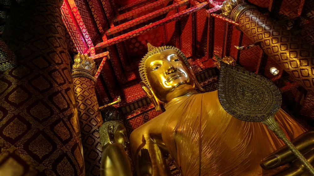 Statue Sculpture Religion Buddha Spirituality Gold Colored Human Representation Art And Craft Close-up Gold Idol Temple - Building Place Of Worship Gilded Golden Red Majestic Focus On Foreground Retail  Culture
