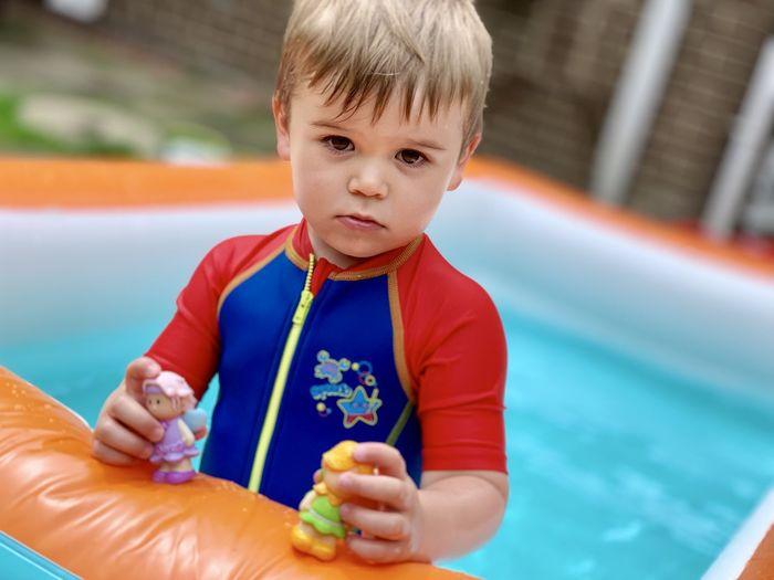 Portrait of cute boy in swimming pool