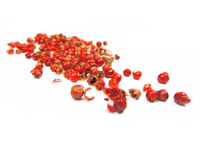 Red peppercorns, isolatede on white with selective focus. Isolated Red Pepper Blur Close-up Food Food And Drink Freshness Fruit Healthy Eating High Angle High Angle View Indoors  Isolated On White Isolated White Background No People Pomegranate Red Red Peppercorn Red Peppercorns Selective Focus Spice Spices Still Life Top View White Background