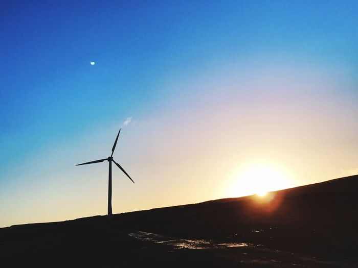 Renewable Energy Windturbine Sunrise Coldmornings Nature Blue Sky Sun Sunlight Beauty In Nature Environmental Conservation Eyeemphotography EyeEm Nature Lover EyeEm Best Shots - Sunsets + Sunrise Outdoors Scenics Cold Weather Backgrounds