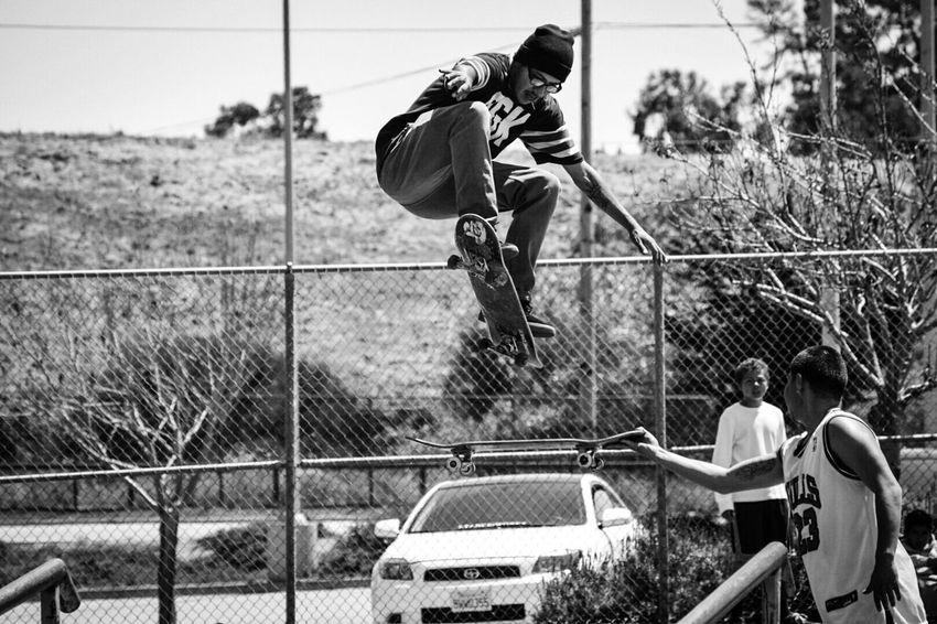 Focus On Foreground Real People Lifestyles Day Outdoors Full Length One Person Men People Adult skateboard skating thrasher black and white