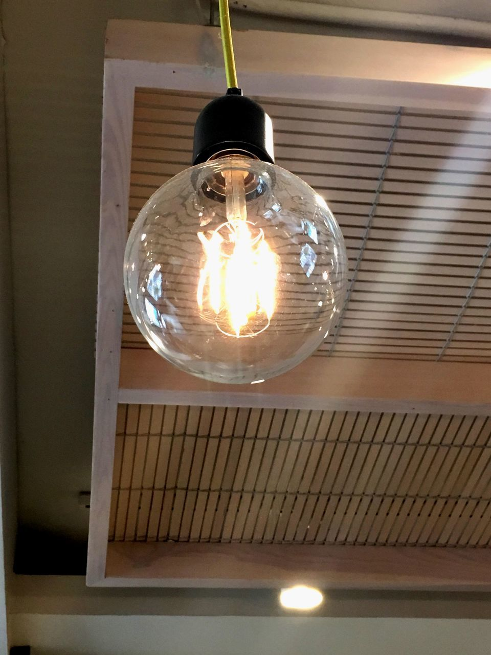 light bulb, illuminated, lighting equipment, electricity, indoors, filament, low angle view, electric light, glowing, ceiling, light, no people, hanging, close-up, technology, transparent, fuel and power generation, glass - material, pendant light, connection, electrical equipment, electric lamp, power supply