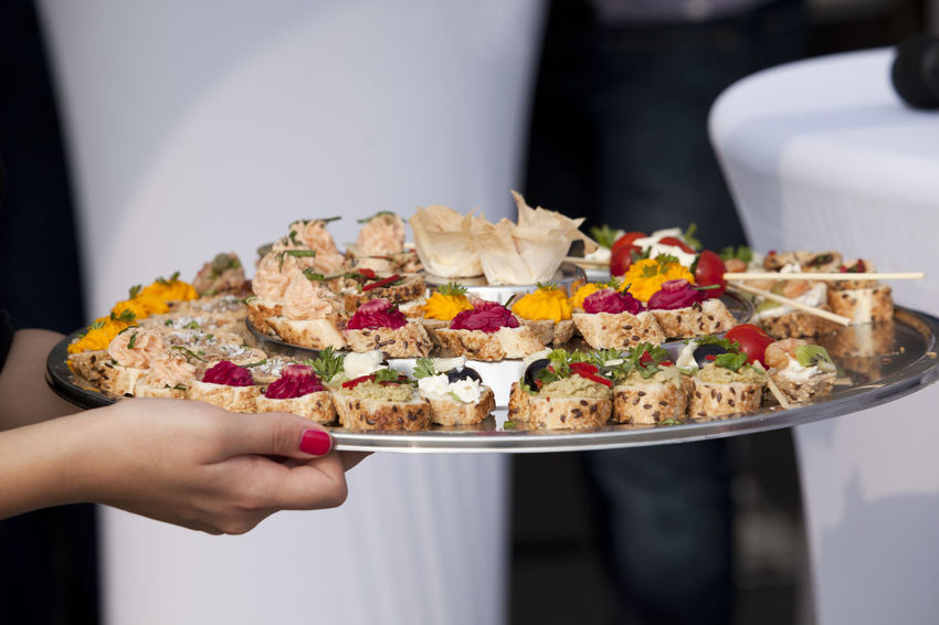 Platter with finger food Carrying Reception Snack Waitress Working Appetizer Banquet Buffet Food Canapes Catering Catering Food Delicious Finger Food Food Food And Drink Holding Human Hand Party Plate Platter Ready-to-eat Restaurant Serving Tasty